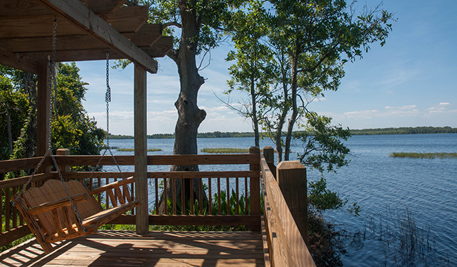 View of a porch swing on Harmony's dock