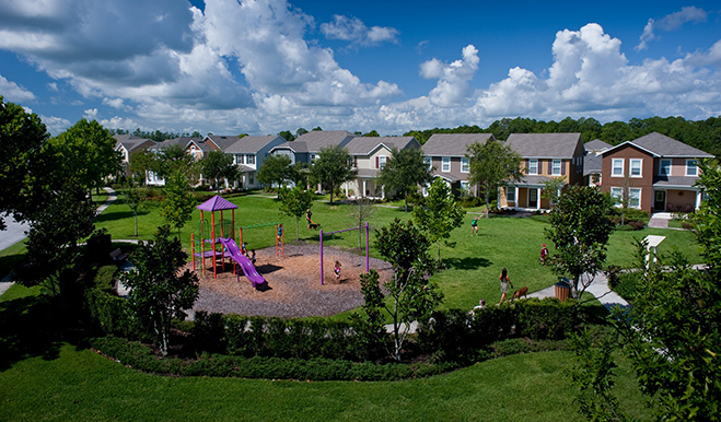 Playground in the foreground; single-family homes in the background