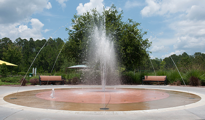 Splash pad with water jetting into the sky