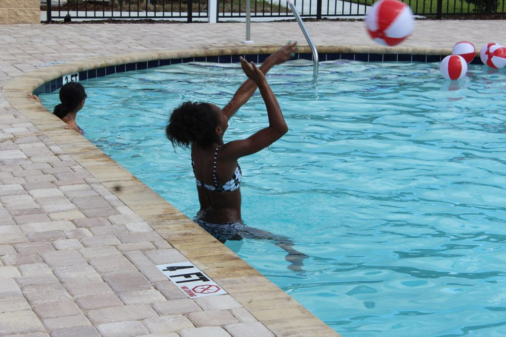 Guests enjoying the community swimming pool at a recent Open House in Florida.