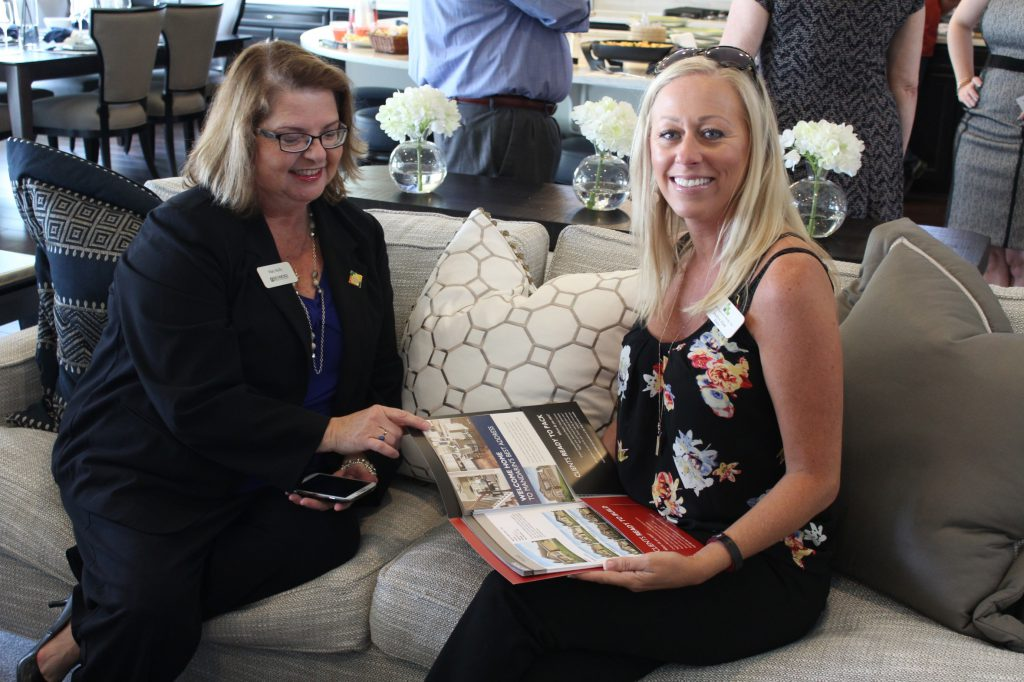 Richmond American sales associate discussing a new community's floor plans with a local real estate agent.