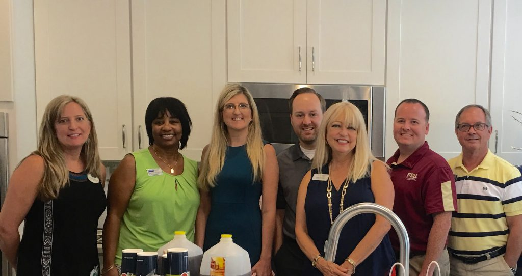 Real estate agents enjoying an agent appreciation lunch.