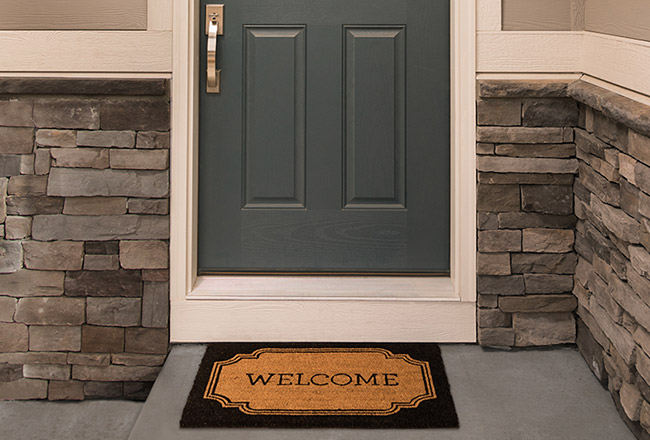 Front door and doormat