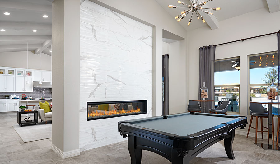 Game room with optional two-sided fireplace | Ryder model home
