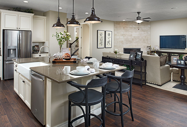 <b>The open-concept main floor.</b><br> The Coronado's kitchen is at the heart of the action, surrounded by a great room and dining area designed for easy entertaining. Buyers who build from the ground up can choose to add a sunroom/morning room to expand the space even more! Shown: The Coronado model in Utah.