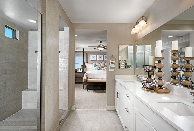 <b>The master suite.</b><br> Spanning the back of the second floor, the Coronado's master suite includes an inviting bedroom, spacious bath with deluxe options and a roomy walk-in closet. Shown: The Coronado model in Arizona.