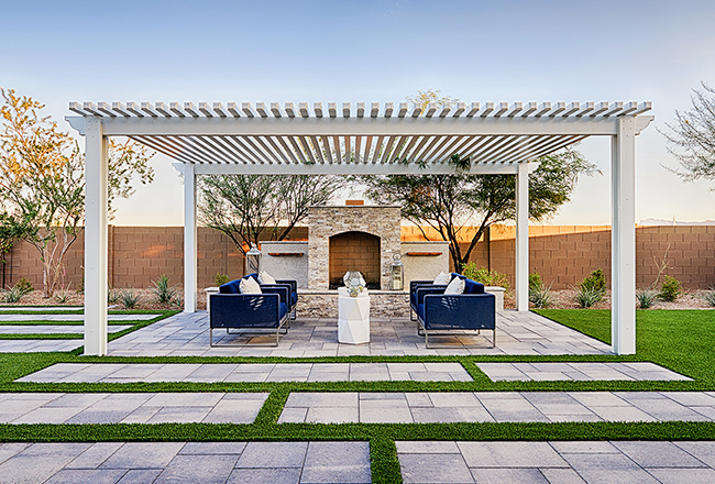 <strong>Why do we love it?</strong><br />A stately pergola and outdoor fireplace crank up the wow factor in this already spectacular model home near Phoenix.