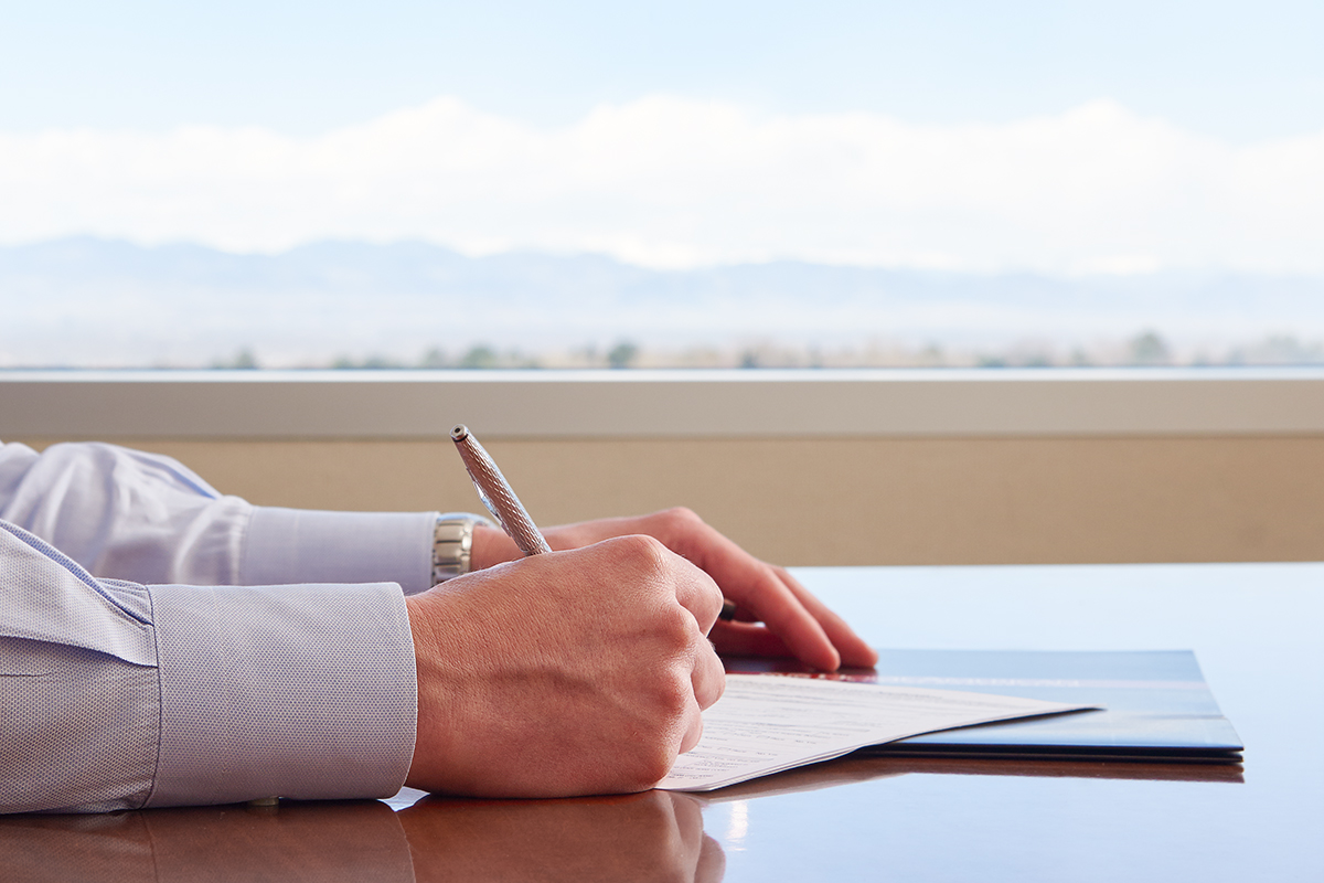 Signing paperwork for mortgage and insurance