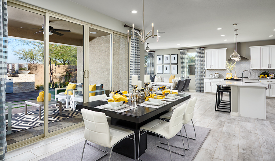 The airy dining area includes access to the covered patio.