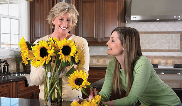 mother.daughter.kitchen.sunflowers.lifestyle.1.w