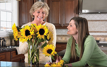 Mother and daughter arranging fresh-cut flowers