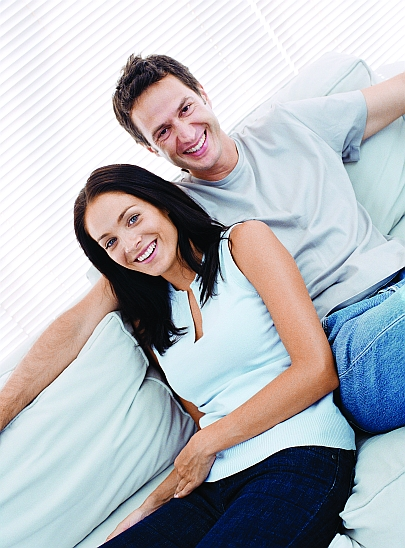 Homebuyers sitting on a sofa