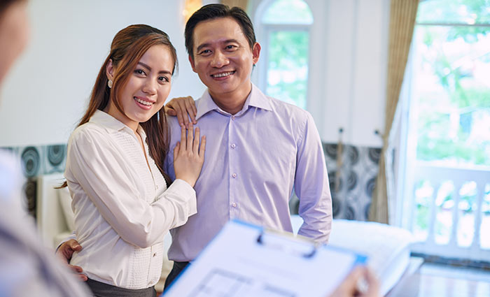 Couple with Real Estate Agent