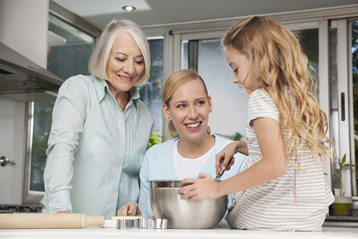 Grandmother, Mother, and Daughter Cooking for Mother's Day