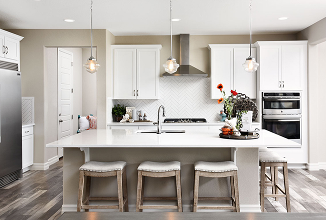 School House pendant lighting in white kitchen with large island