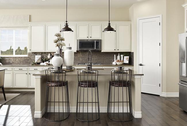 Fresnel Lighting Pendants over kitchen island with bar stools