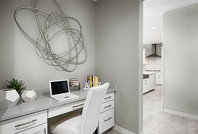 <h3 style='color:#ffffff;'>Tech Center</h3>This built-in workspace makes a great homework station or a place to get work done without closing yourself away in a separate room. It's included in many of our <a href='https://www.richmondamerican.com/campaigns/364' target='_blank' rel='noopener noreferrer'>Seasons™</a> and <a href='https://www.richmondamerican.com/campaigns/896' target='_blank' rel='noopener noreferrer'>Cityscape™</a> Collection plans and an available option in other homes.