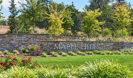 Monument at the entrance of the Maple Hills community