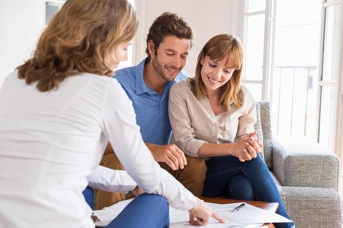 Realtor meeting with couple