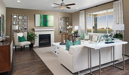 Family room with fireplace in the Alcott floor plan
