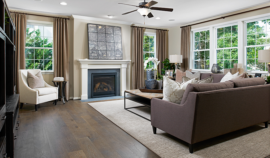 Family room with fireplace in the Amherst floor plan