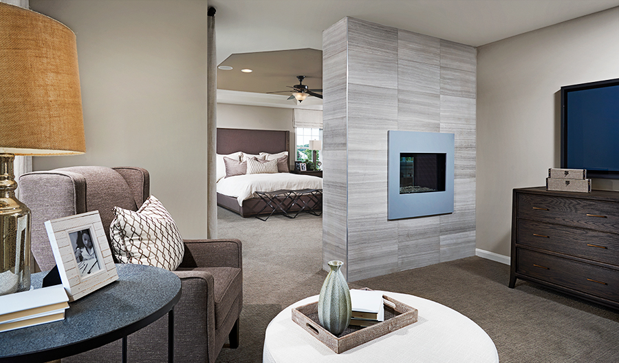 Master bedroom with fireplace in the Amherst floor plan
