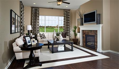 Family room with fireplace in the Anika floor plan