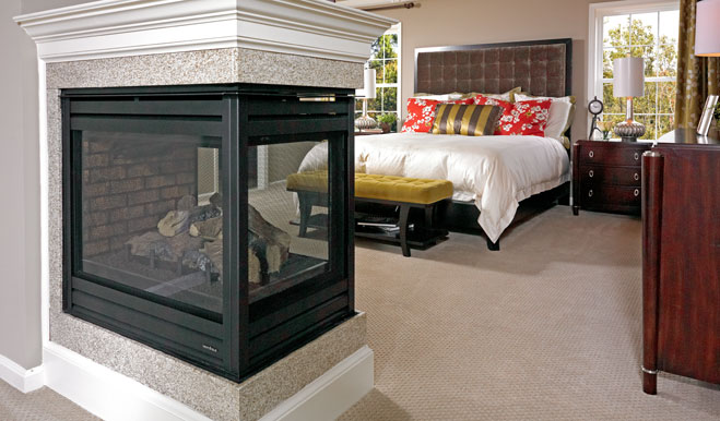 Master bedroom with fireplace in the Darby floor plan