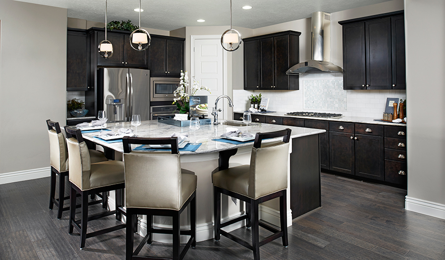 Kitchen with large center island in the Darla floor plan