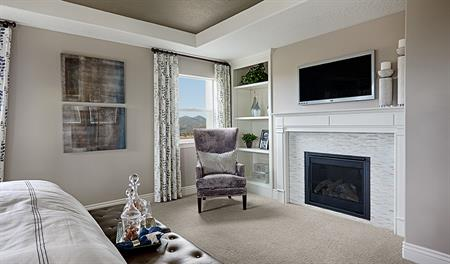 Master bedroom with fireplace in the Darla floor plan