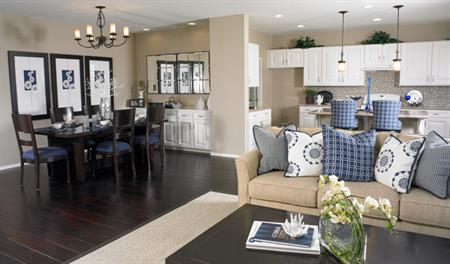 Family and dining room in the Denise floor plan