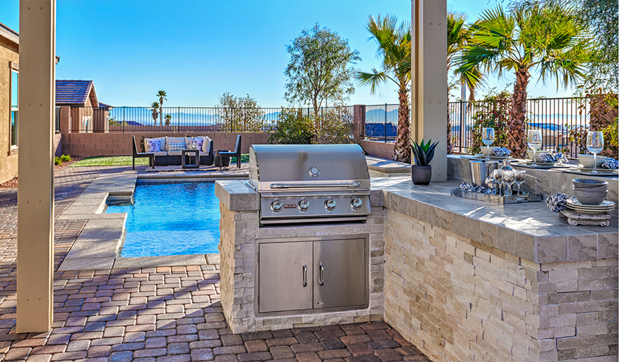 Outdoor kitchen and pool in the Hanford floor plan