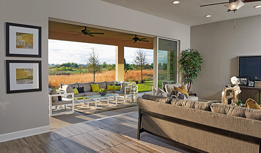 Family room and patio in the Harmon floor plan