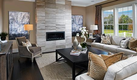 Family room with fireplace in the Harmon floor plan