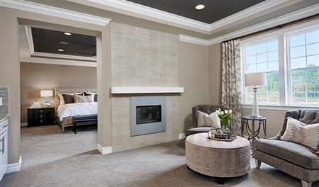 Master bedroom with fireplace of the Harmon floor plan
