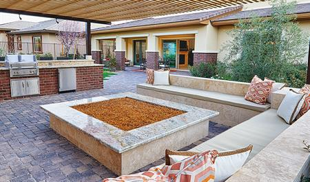 Patio with fire pit and grill in the Hartman floor plan