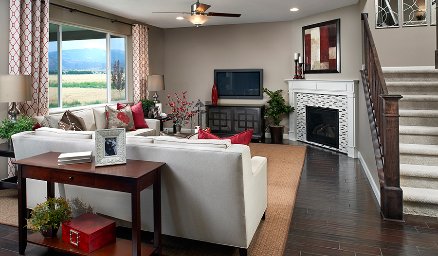 Family room with fireplace in the Hemingway floor plan