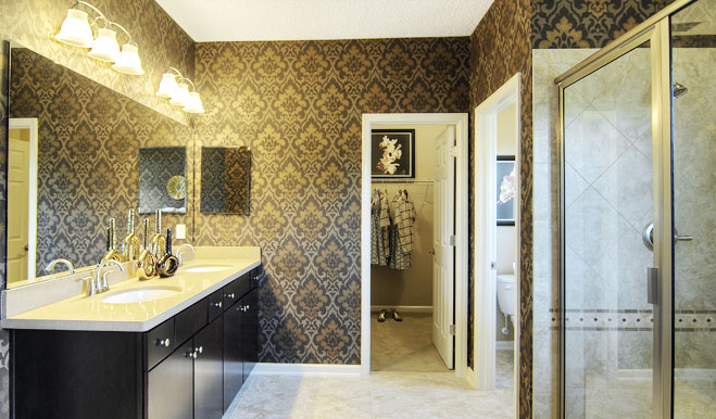Master bathroom with attached walk-in closet in the Isaac floor plan