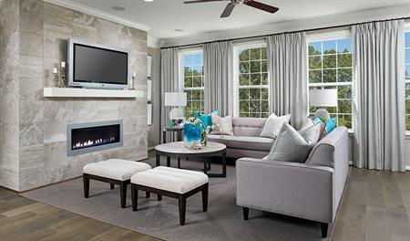 Family room with fireplace in the Kenrick floor plan