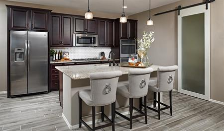 Kitchen with center island in the Arlington floor plan