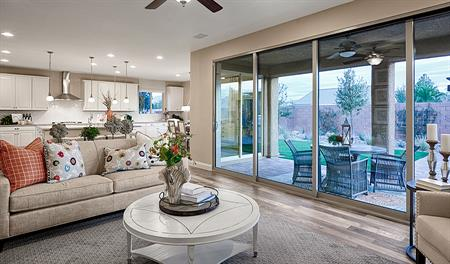 Great room with sliding glass doors in the Sage floor plan