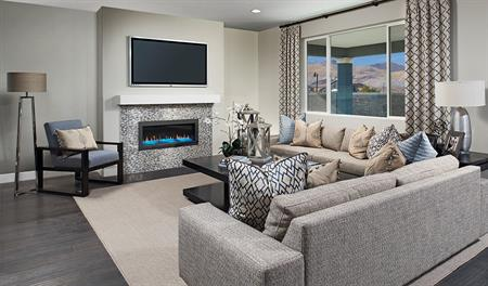 Family room with fireplace in the Yorktown floor plan