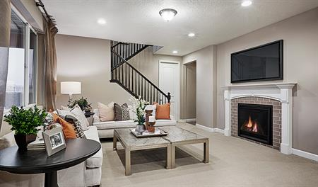 Family room with fireplace in the Hopewell floor plan