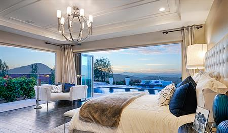 Master bedroom with mountain view in The Reilly floor plan