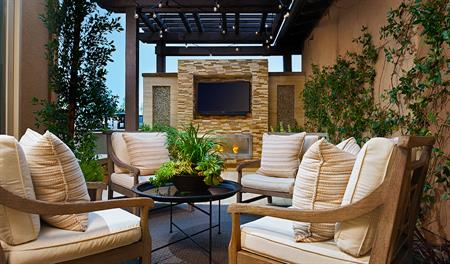 Outdoor sitting area with fire place in the Rockwell floor plan