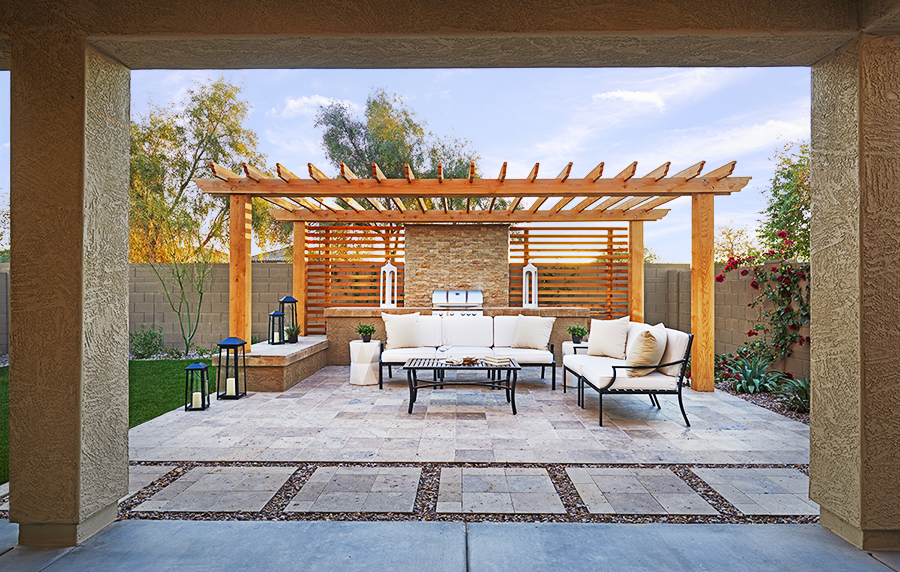 Patio with sitting area and grill in the peridot floor plan