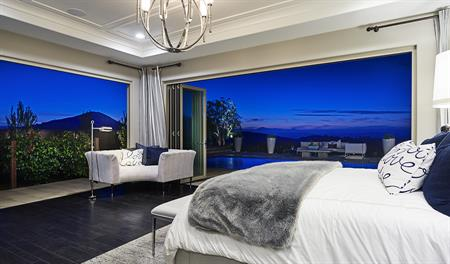 Master bedroom night view in the Reilly floor plan