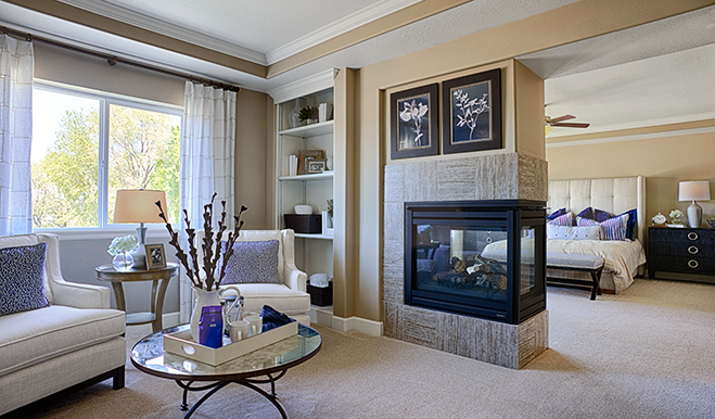 Master bedroom with fireplace in the Harlow floor plan