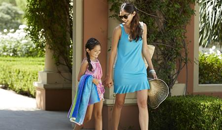 Mother and daughter going to pool