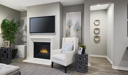 Family room with fireplace in the Paige floor plan